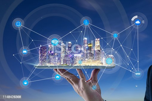 istock Waiter hand holding an digital tablet with Smart city 1148426368