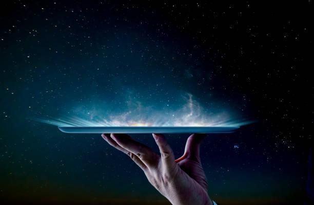 Waiter hand holding an empty digital tablet stock photo