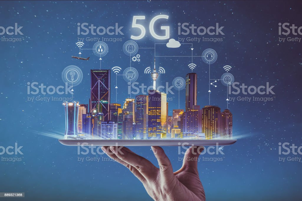 Waiter hand holding an empty digital tablet with smart city and 5G network wireless systems and internet of things . stock photo