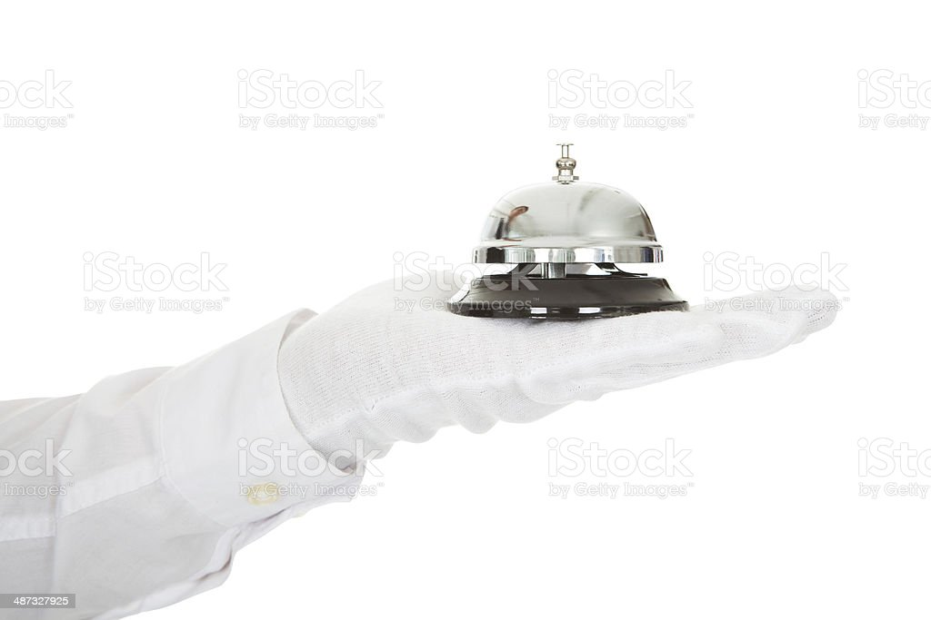 Waiter Holding A Service Bell In Hand stock photo