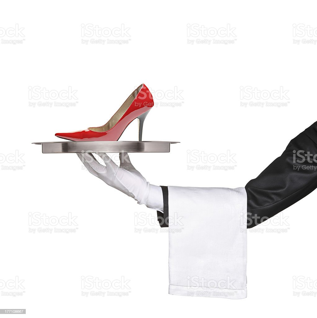 Waiter holding a silver tray with high heel on it stock photo