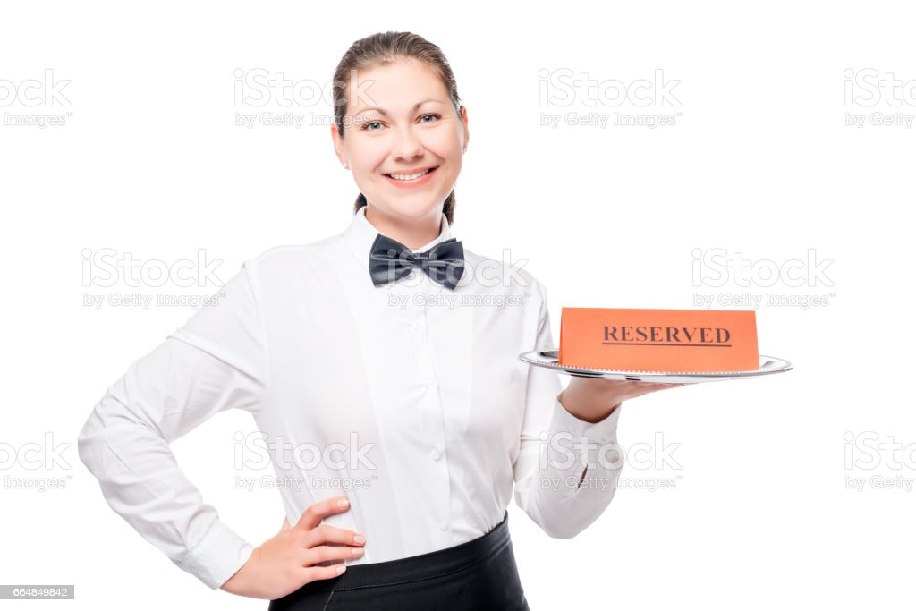 waiter holding a tray of an advertisement for the reservation and smiling stock photo