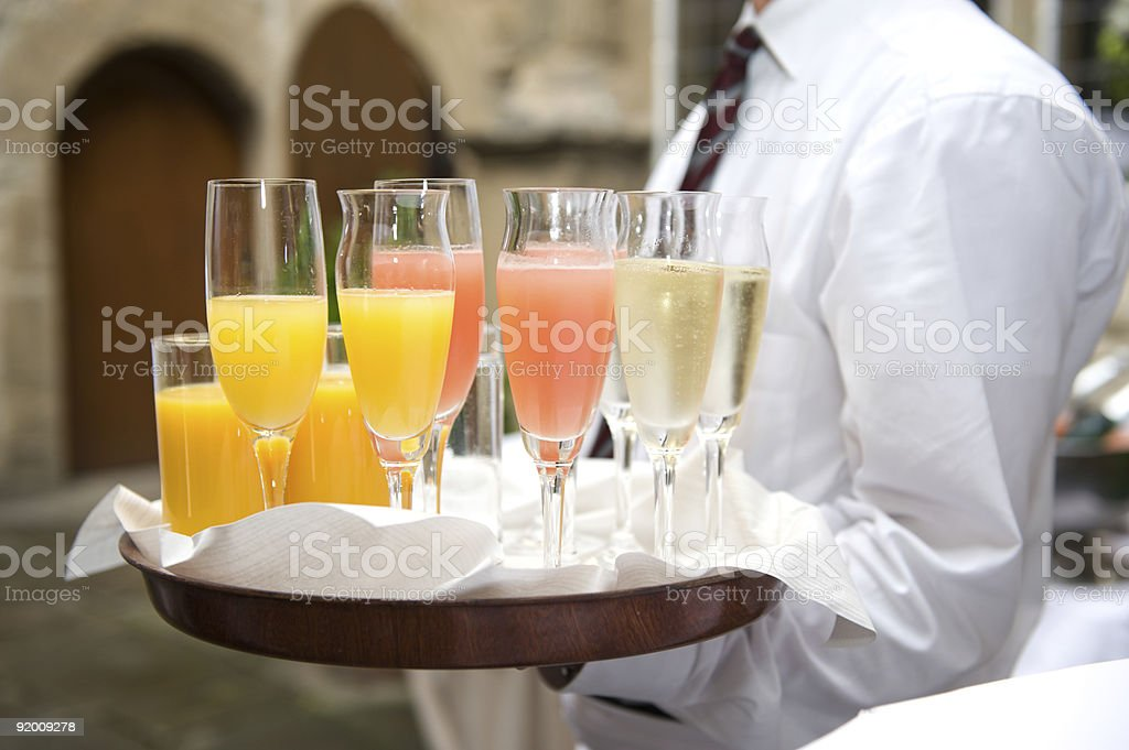 Waiter holding a tray with champagne glasses at the wedding stock photo