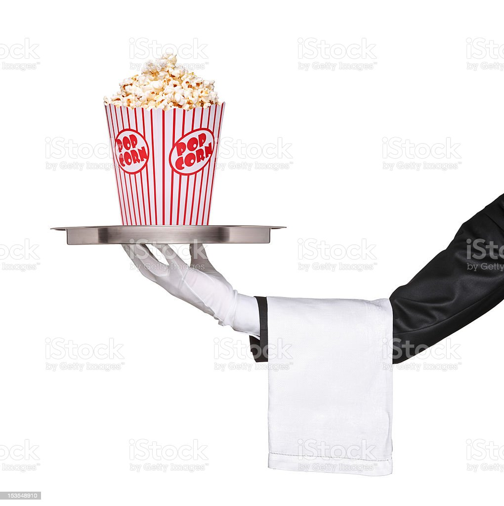 Waiter holding a tray with popcorn box on it royalty-free stock photo