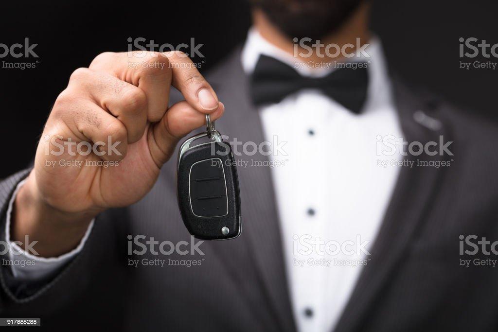 Waiter Holding Car Key stock photo