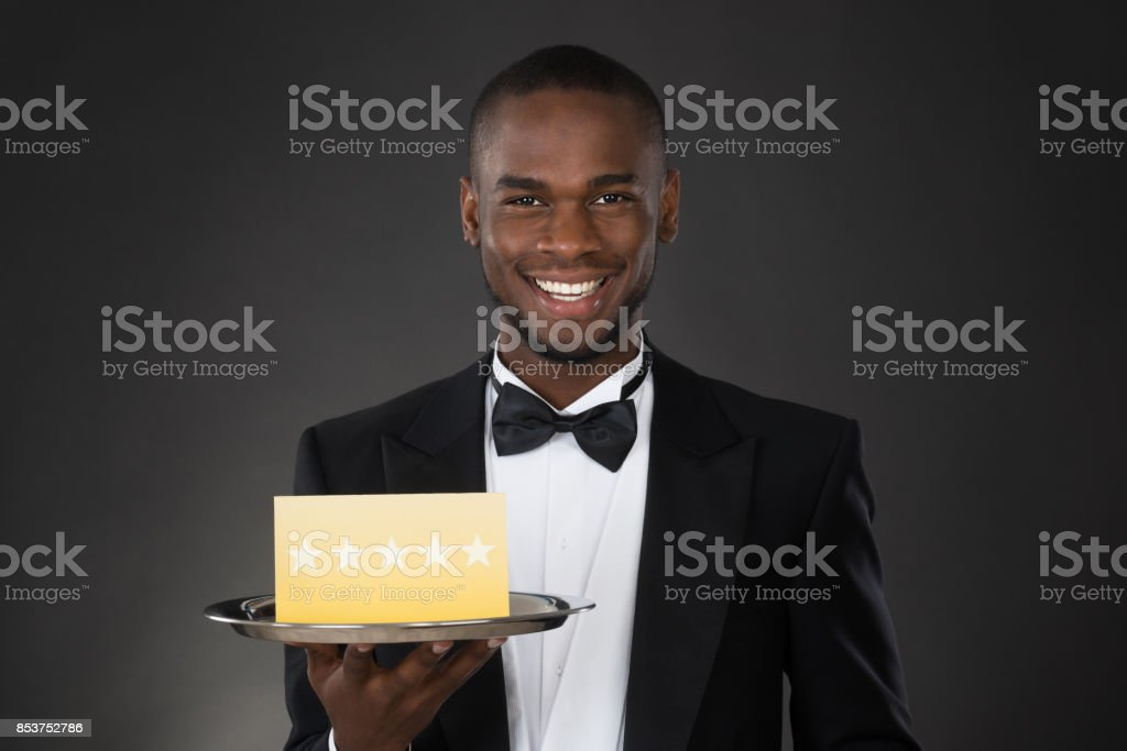 Waiter Holding Plate With Star Rating stock photo
