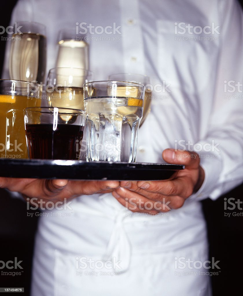 Waiter Holding Tray Of Alcoholic Drinks Stock Photo & More