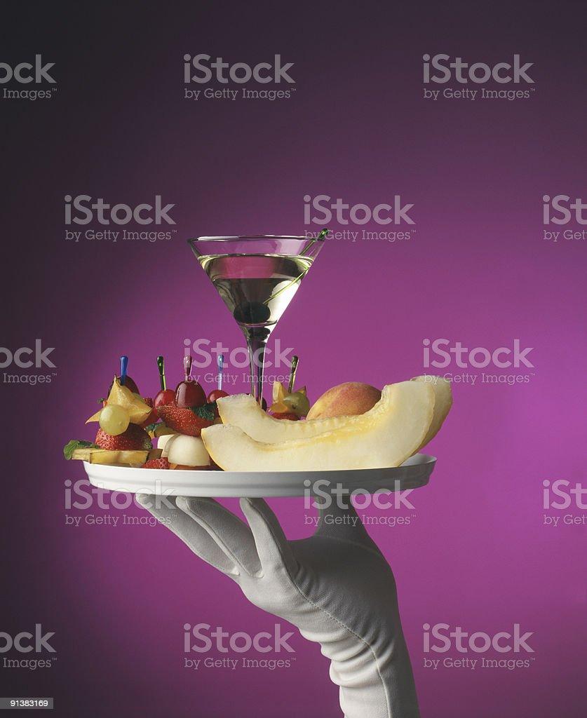 Waiter holding tray with Martini royalty-free stock photo