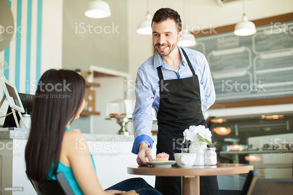 Waiter in a coffee shop stock photo