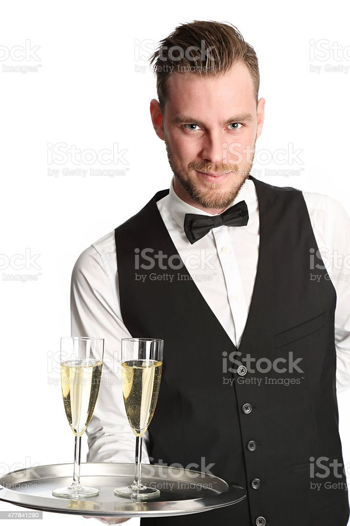 Waiter in his 20s serving champagne stock photo