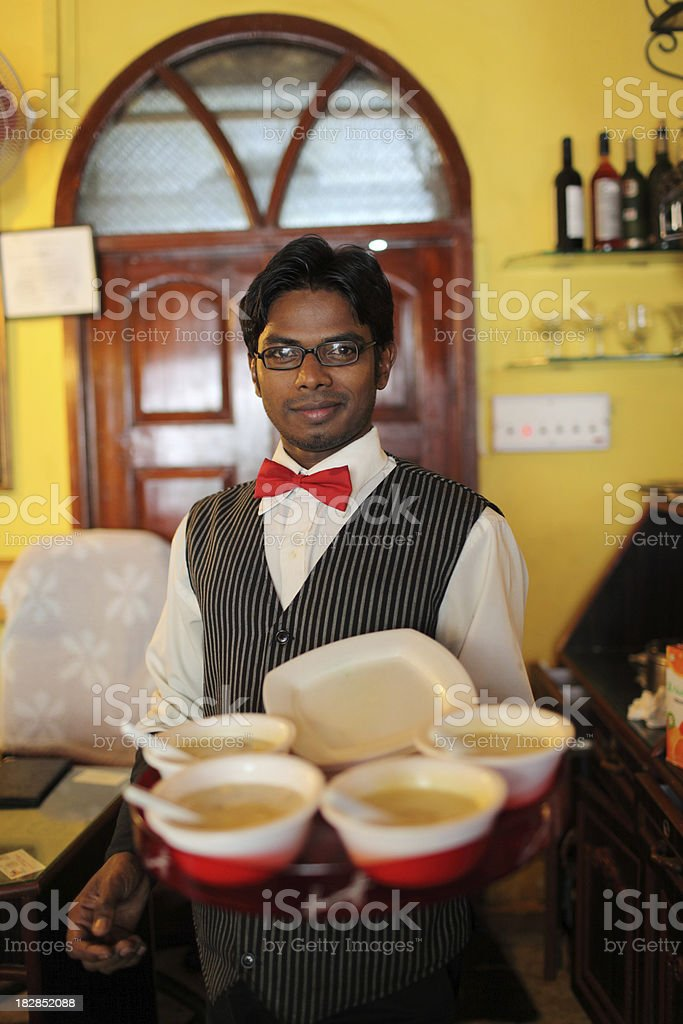 Waiter in Panjim stock photo