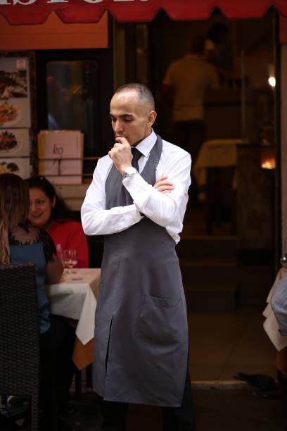 A Waiter in Venice Italy stock photo