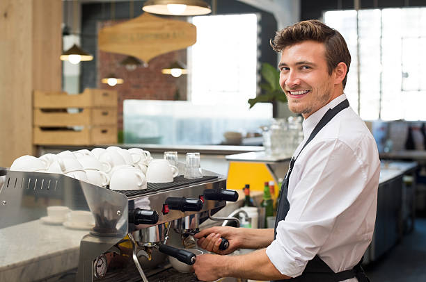 waiter making coffee - barista making coffee stock photos and pictures