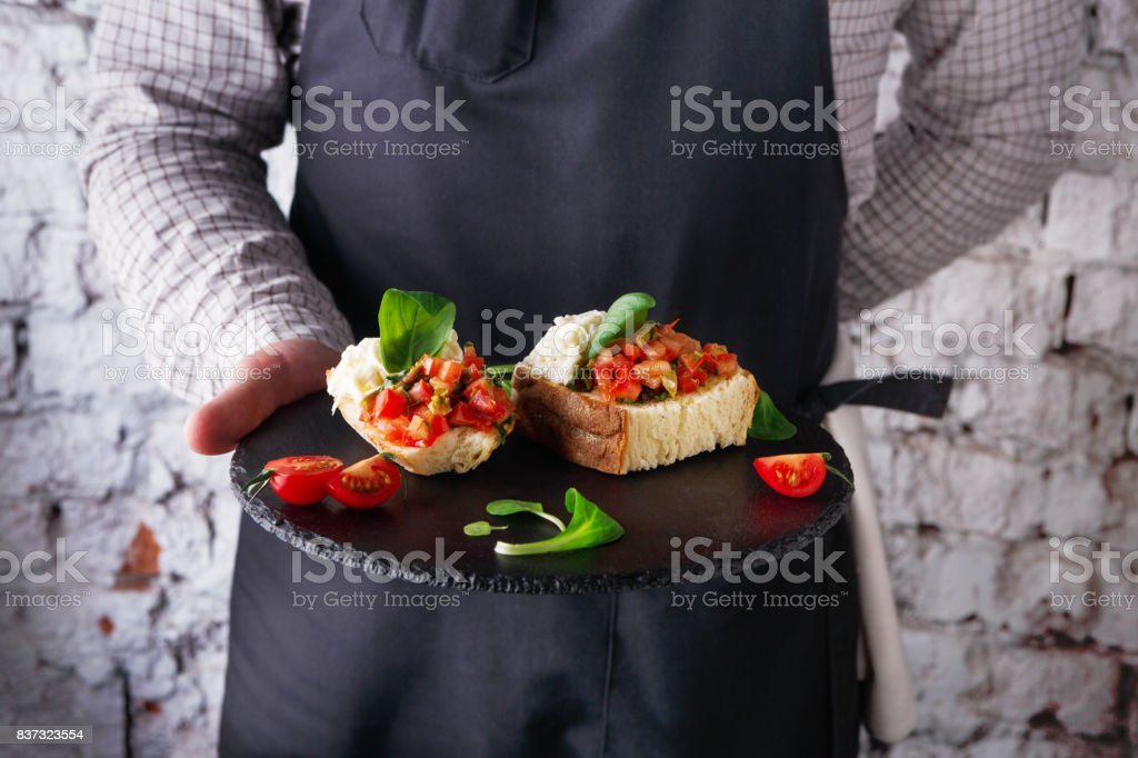 Waiter offering delicious restaurant dish stock photo