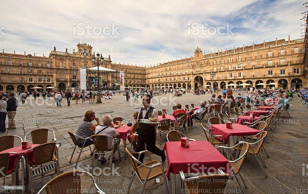 Waiter on Plaza Mayor in Salamanca, Spain stock photo