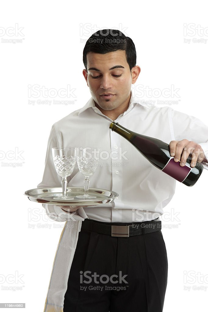 Waiter or bartender pouring wine royalty-free stock photo