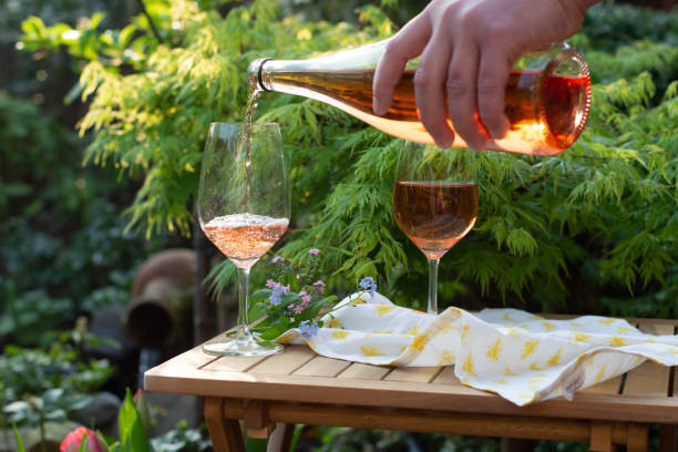 Waiter pouring cold rose wine in glasses on outdoor terrace in garden picture id950515712?b=1&k=6&m=950515712&s=612x612&w=0&h=jzr ur4nzr6kcjqipqt 6ilrax3kfdn3lkanqkbaab8=