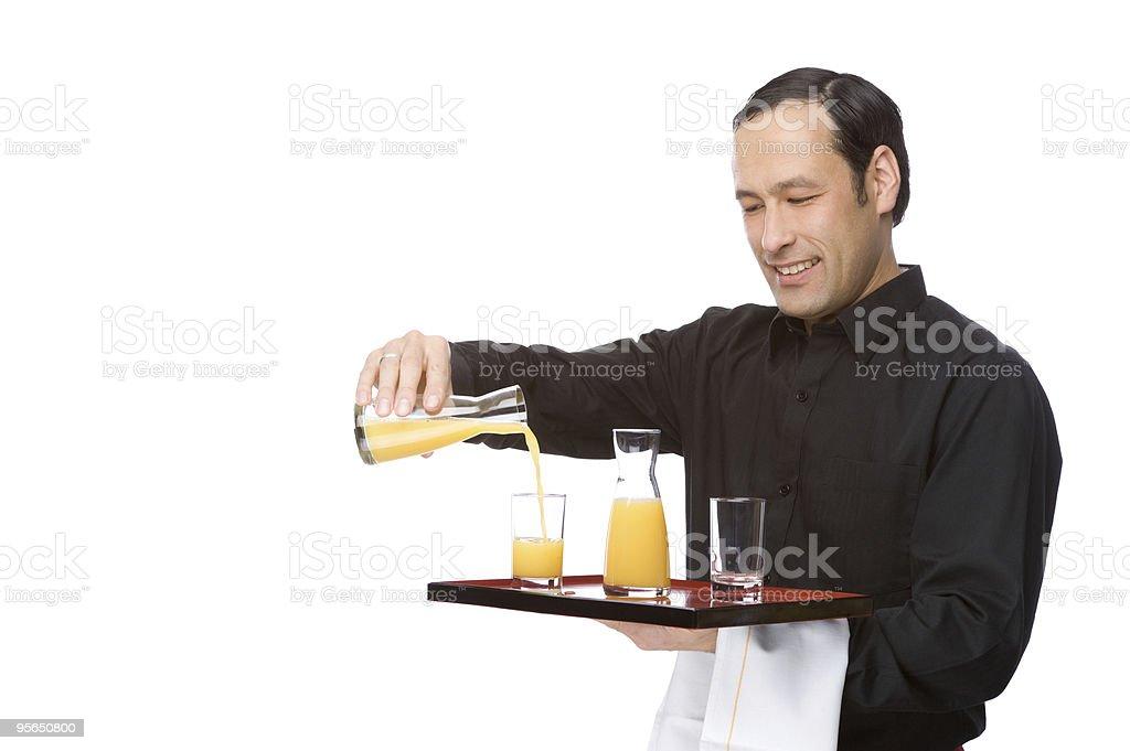 Kellner gießen Saft - Lizenzfrei Arbeiten Stock-Foto