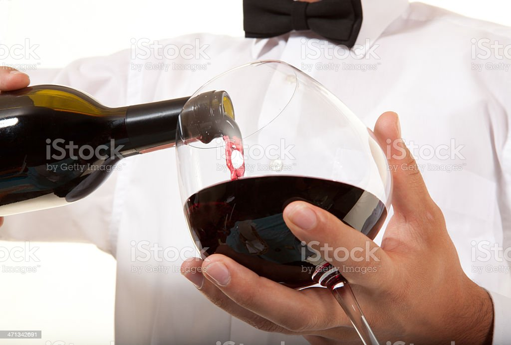 Waiter pouring wine royalty-free stock photo