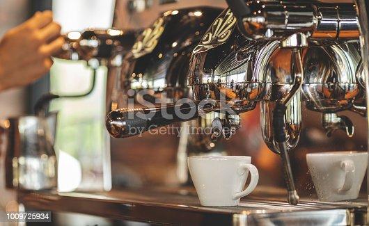 Waiter preparing coffees indoor shot