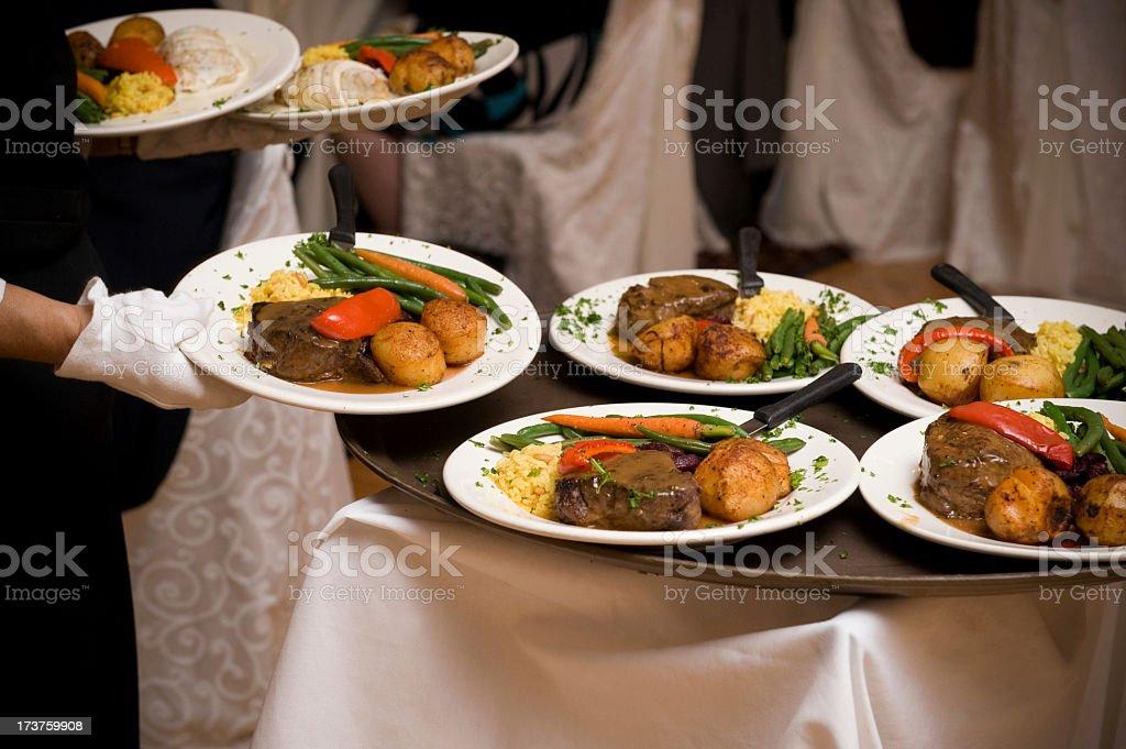 Waiter preparing to serve dinner royalty-free stock photo