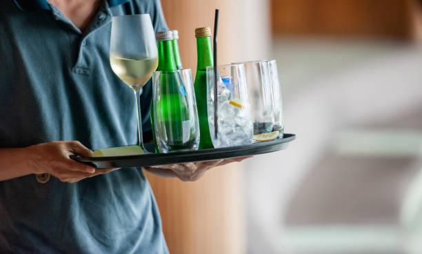 Waiter serves drinks stock photo