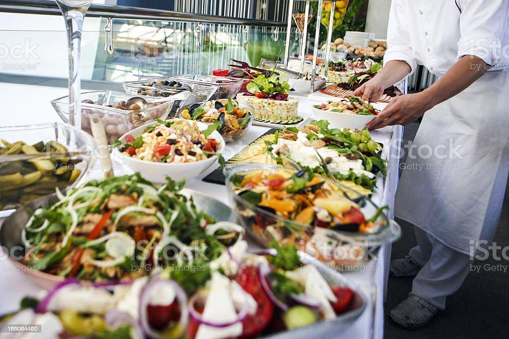 Waiter serving a buffet table