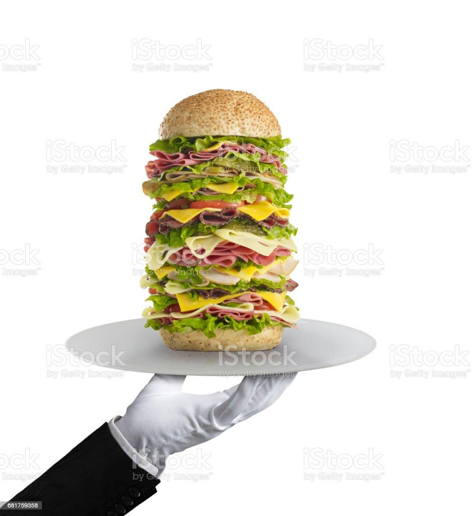 waiter serving a huge sandwich stock photo