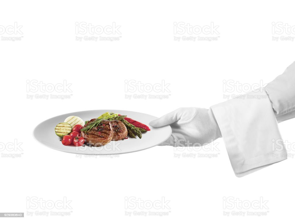 Waiter serving a steak dish stock photo