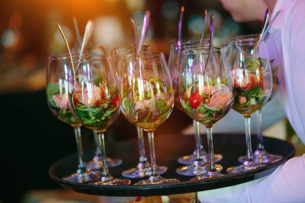 Waiter serving apertif stock photo