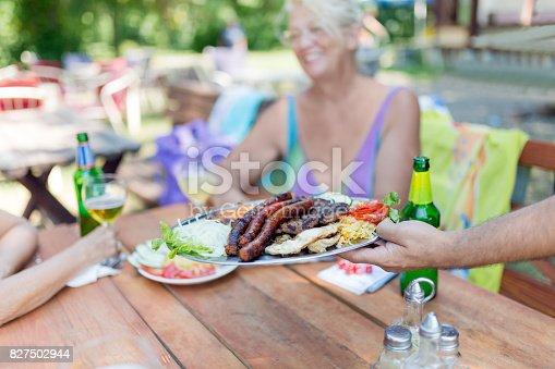 istock Waiter serving bbq 827502944