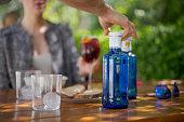 Unrecognizable wait staff serving bottled water, Nikon Z7