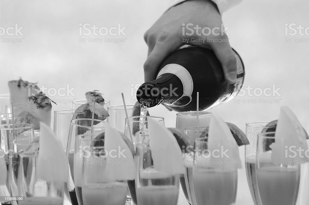 waiter serving cocktail b/w royalty-free stock photo