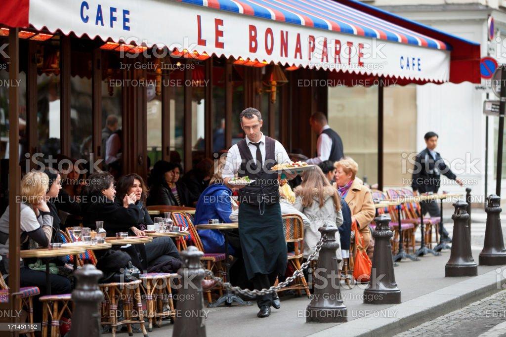 Waiter Serving Food, Cafe Le Bonaparte, Saint Germain, Paris, France royalty-free stock photo