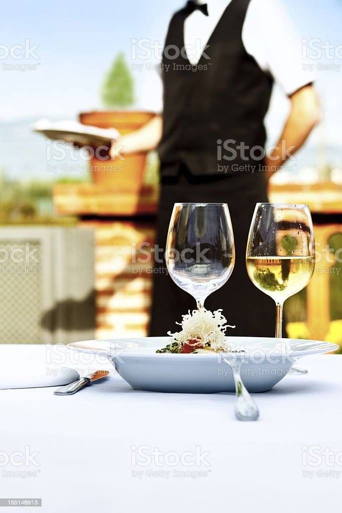Waiter serving in a restaurant royalty-free stock photo