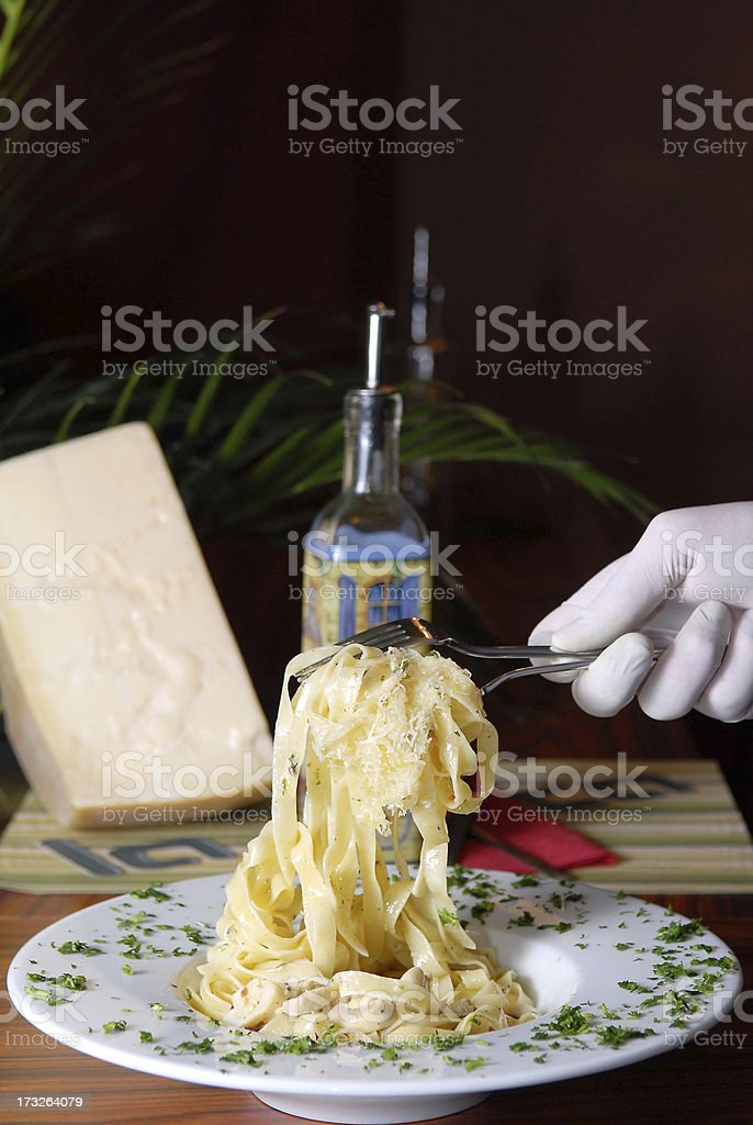 Waiter serving italian past in fancy restaurant royalty-free stock photo