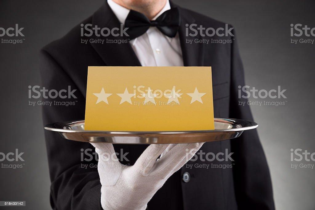 Waiter Serving Star Rating stock photo