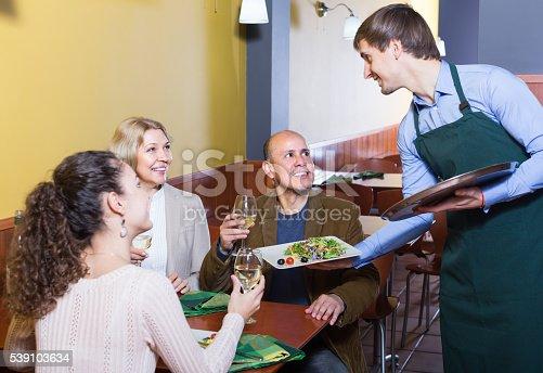 istock Waiter serving table in restaurant 539103634