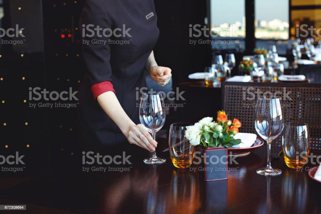 Waiter serving table in restaurant stock photo
