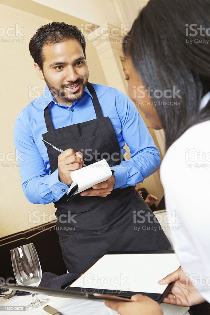 Waiter taking order from restaurant guest royalty-free stock photo