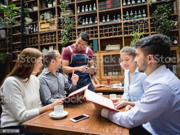 Waiter taking order to a group at a restaurant using a tablet picture id921270108?b=1&k=6&m=921270108&s=612x612&h=wri2n cps7rq3jelpchx6c9riwyncrwend  l0c3ios=