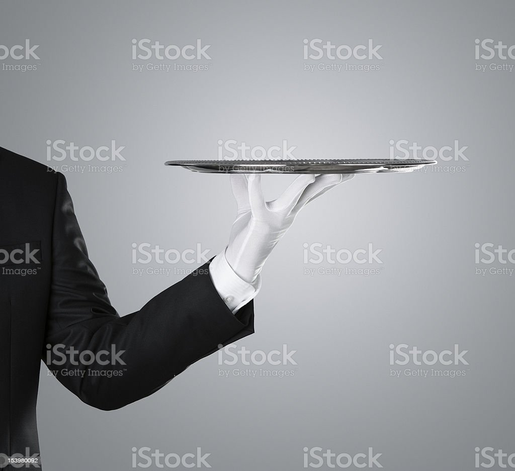 Waiter with empty silver tray royalty-free stock photo