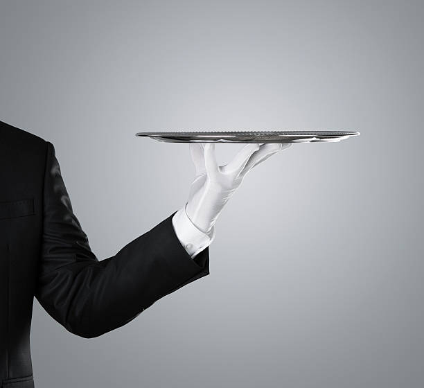 Waiter with empty silver tray stock photo