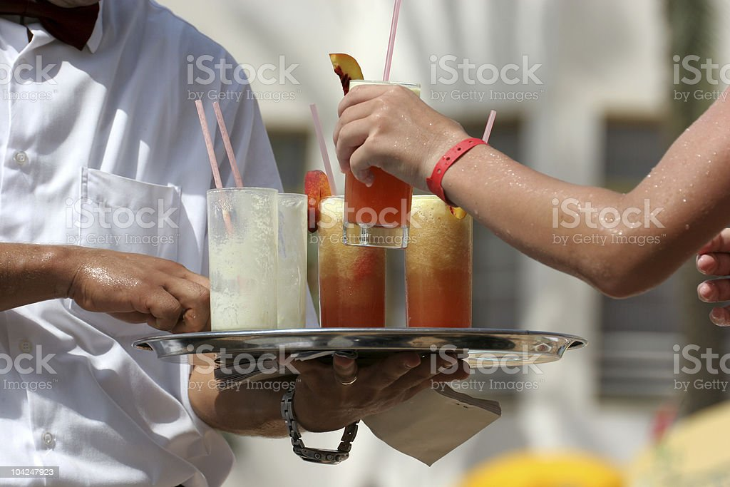 Waiter with fruit cocktails royalty-free stock photo