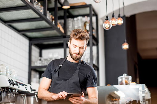 istock Waiter with tablet at the cafe 894624166