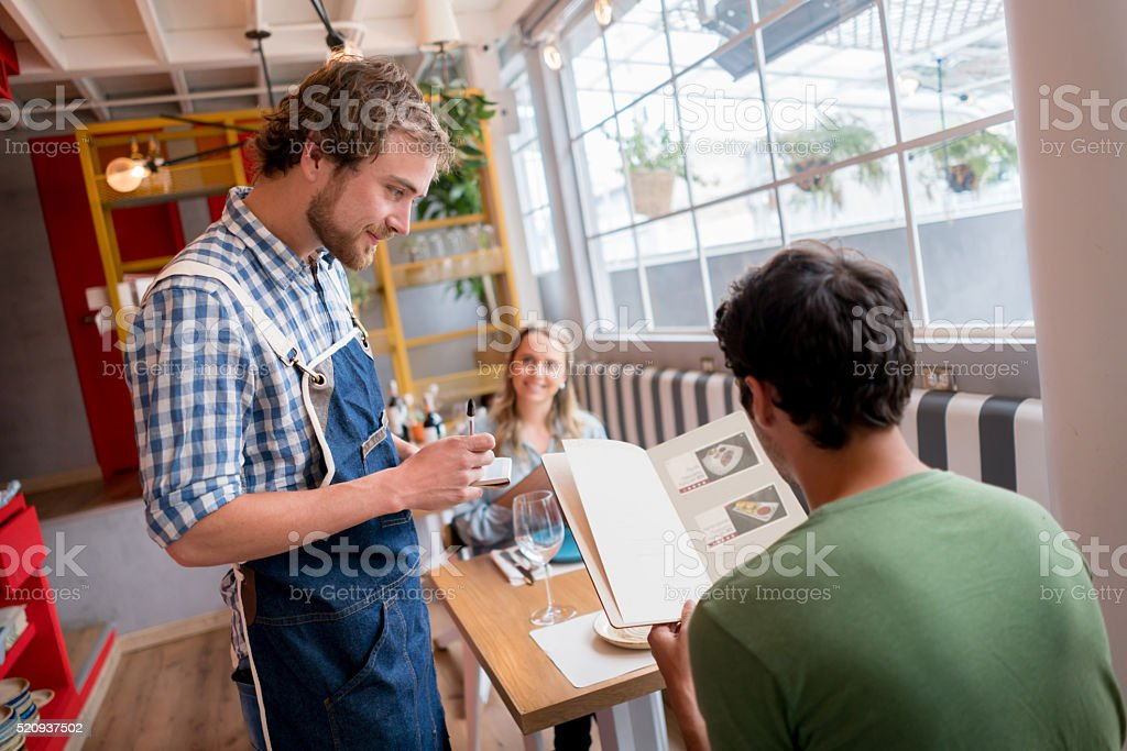 Waiter working at a restaurant stock photo