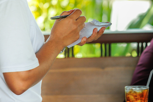 Waiter writing food and drinks order