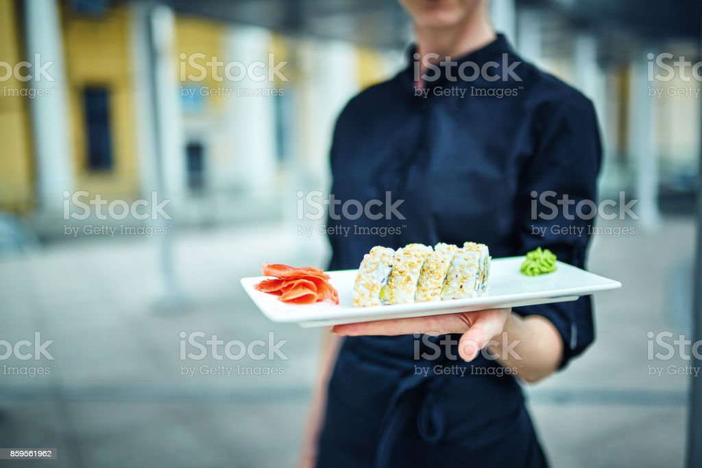 Waiters carrying plates with food, in a restaurant. stock photo