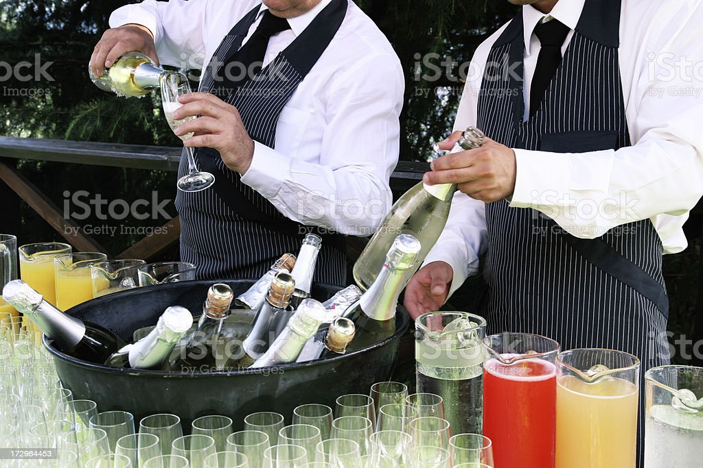 waiters serving champagne royalty-free stock photo