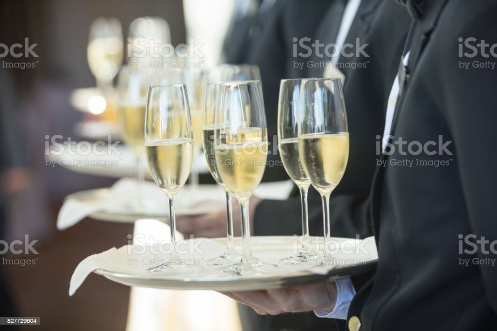 Waiters serving champagne stock photo